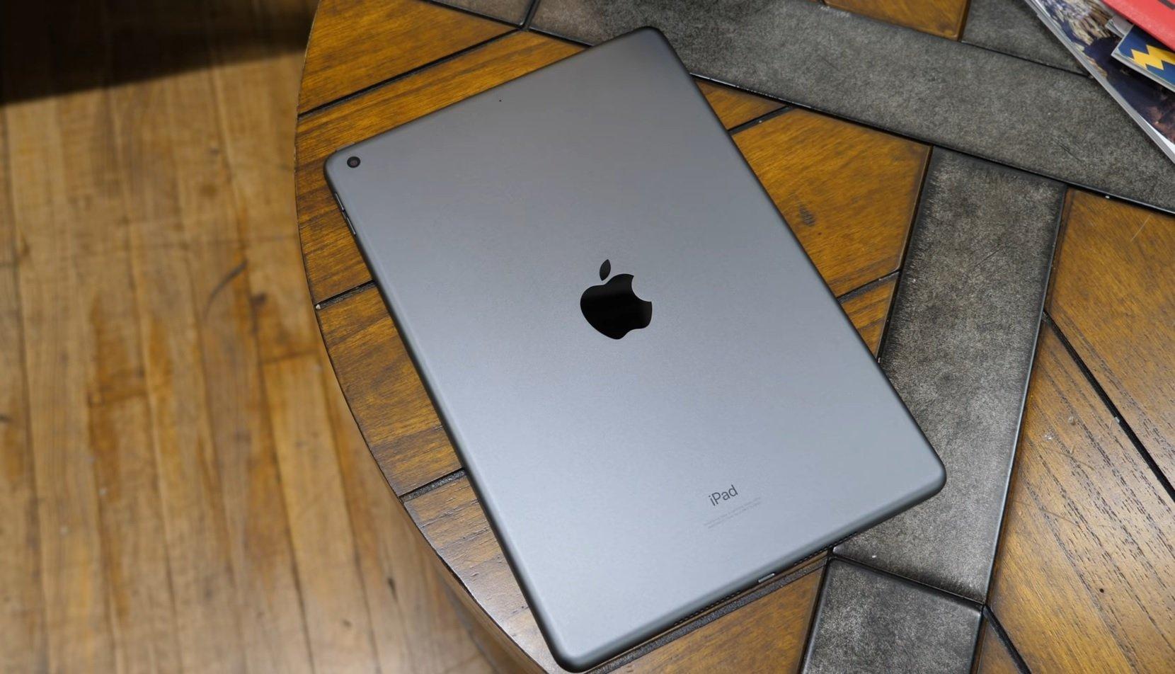 10.2-inch iPad on wooden desk, video screenshot